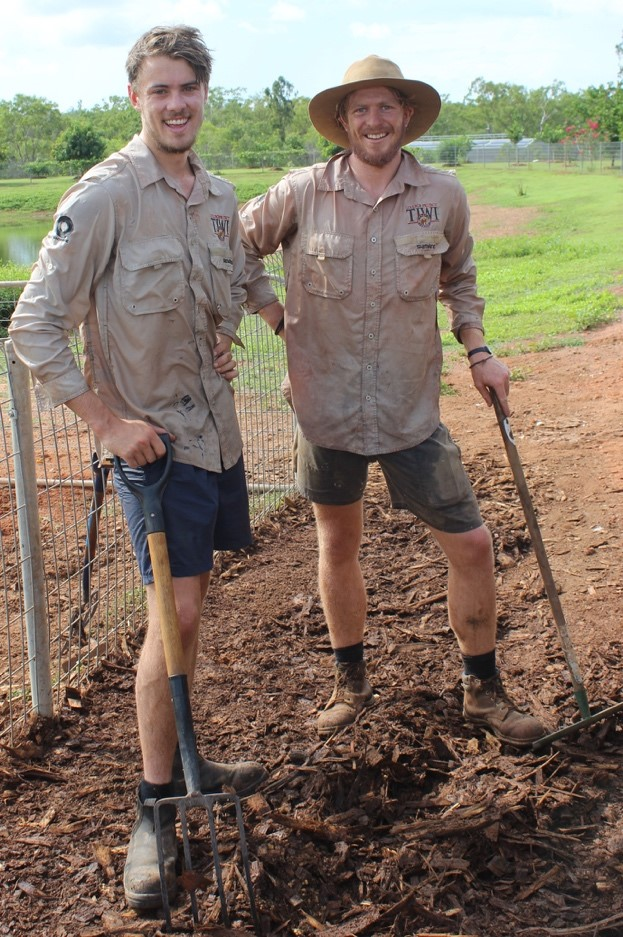 Louis Wardle (left) and Ashley Vines (right) cleaning up in front of the chooks shed. Photo credit: Anne Mcmaster